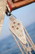 pulley blocks of mainsheet, running rigging of old yacht - stock photo