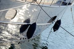 two boat fenders, protecting the side of a sailing vessel - stock photo