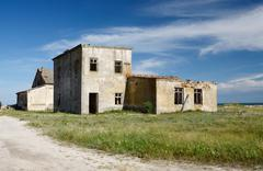 Abandoned houses on wild tendriv island,which is separated into several islands Stock Photos