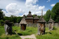 medieval wooden church with old apiary ,ukraine,pirogovo,europe - stock photo