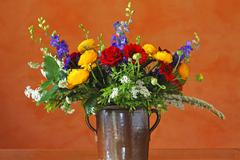 Colourful bouquet of flowers with ranunculus Ranunculus asiaticus roses Rosa - stock photo