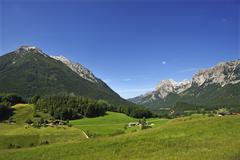 Mt Reiter Alpe right Mt Hochkalter left alpine pastures at front Ramsau bei Stock Photos