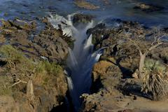 Epupa Falls waterfalls of the Kunene River on the Namibian Angolan border - stock photo
