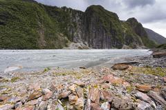 Glacial valley with abraded mountain edges of the Fox Glacier Fox Glacier - stock photo