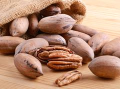 stack full of pecan nuts - stock photo