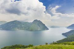Corna Trentapassi 1248m and Monte Isola island in Lake Iseo or Lago dIseo - stock photo