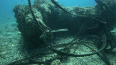 Rubber strips from old vehicle tires used as boat mooring lines Stock Footage