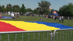 Sky Diving Contest Romanian Flag On Grass, Officials, Spectators, Pan - stock footage