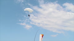 Sky Diver In A Sky Diving Contest, Summer, Blue Sky, Lading, Follow Shot - stock footage
