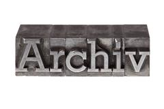 """old lead letters forming the word """"archiv"""", german for """"archive"""" - stock photo"""