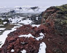 Lava formations in the thermal area of Leirhnjukur covered with snow and ice - stock photo