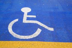 Handicapped parking pictogram painted on an asphalt parking lot Montreal Quebec Stock Photos
