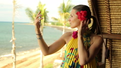 Pretty woman in exotic dress loking herself in the mirror HD Stock Footage