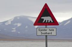 Polar bear warning sign Longyearbyen Spitsbergen Island Svalbard Archipelago - stock photo