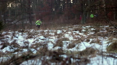 Stock Video Footage of Cross-Country runners in the  woods