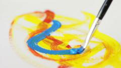 Painting with a brush on the peace of paper, art, fantasy, camera movement - stock footage