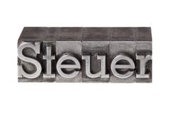 "old lead letters forming the word ""steuer"", german for tax - stock photo"