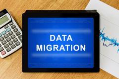Data migration word on digital tablet Stock Illustration