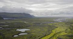 View towards the coast over the Skeioararsandur outwash plain Skaftafell - stock photo