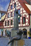 Statues wearing gloves on the Gauklerbrunnen well by artist Harro Frey an old Stock Photos