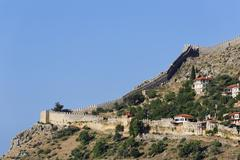 Fortress walls or ramparts on the hill Alanya Castle Tophane quarter Tophane - stock photo