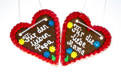 Gingerbread hearts with the writing Fuer den lieben Papa and Fuer die liebe Stock Photos