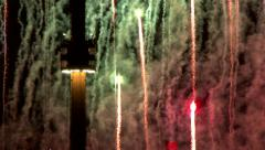 4K UHD - 60fps or 30fps - Red and green fireworks flying fast near tower Stock Footage