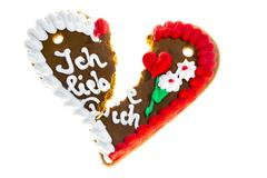 Broken gingerbread heart with the message Ich liebe Dich German for I love you Stock Photos
