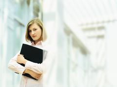 Businesswoman holding a ring binder Stock Photos