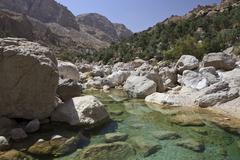 Clear water in the Wadi Shab mountain ravine Hadjar Gebirge Hadschar Gebirge - stock photo