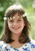 Smiling girl wearing a floral garland portrait Stuttgart Baden Wurttemberg - stock photo