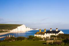 Stock Photo of Houses in front of the Seven Sisters chalk cliffs Seaford Sussex England United