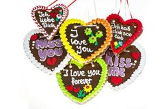 Various gingerbread hearts with declarations of love Stock Photos