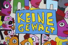 Colourful mural with the words Keine Gewalt German for no violence on a wall of - stock photo
