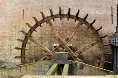 Cogwheel drive the watermill. Stock Photos