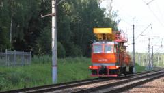 Railcar moves ahead on rails. Logo was blurred. Stock Footage