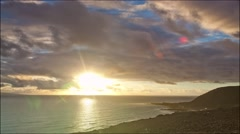 Timelapse,sunset,clouds flying over the sea Stock Footage