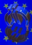 Stock Photo of Miniature figure of a worker is carrying the Euro symbol symbolic image burden