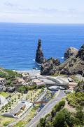 Ilheus da Rib rock formations on the cliff coast of Ribeira da Janela Lanceiros - stock photo