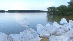 Sandbag Wall on the river - stock footage