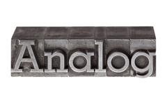 """Stock Photo of old lead letters forming the word """"analog"""", german for """"analogue"""""""