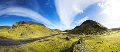 Road through the mountains in the highlands Southern Region Iceland Europe - stock photo