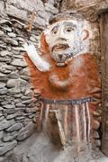 Animistic figure as a guard at the entrance to a house Kagbeni village Lower Stock Photos