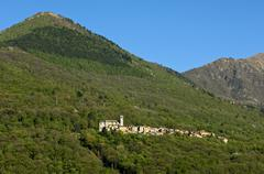 The hamlet of SantAgata at Cannobio in a deciduous forest on a mountain slope Stock Photos