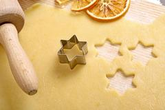 cookie dough with cut-out stars - stock photo