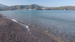 Chalis beach turkey_ slow camera movement across shore and mountain scenery Stock Footage