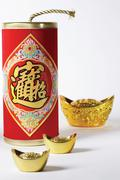 fireworks and yuanbaos for celebrating chinese spring festival - stock photo