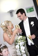 Bride and groom toasting with champagne glasses Stock Photos