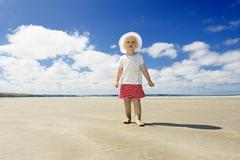 Little girl walking along a beach, brittany, france, europe Stock Photos