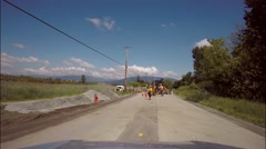 Highway construction, workers on road, Canada Stock Footage